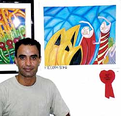 Ardeshir Gholipour in front of some of his Award-winning paintings while in the Port Hedland detention centre