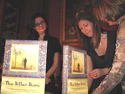 The girls of Pan MacMillan Australia at the table with the book The Bitter Shore
