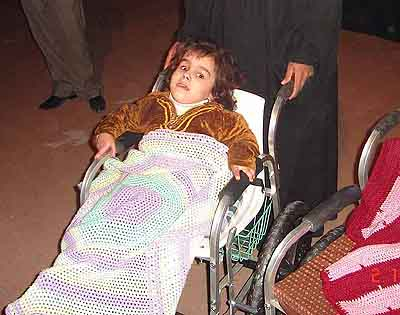 One of the Iraqi children who received one of Riyadh's wheelchairs