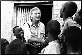 Mark Raper SJ, talking to refugees in Rwanda