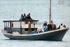 14 Kurdish Asylum seekers approach Melville Island in search of refuge, only to be towed all the way to Indonesia