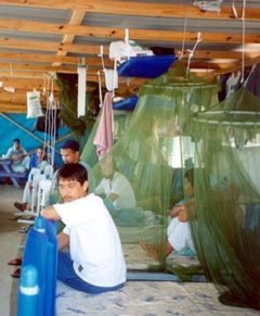 Asylum seekers in the dormitory in Nauru's Topside Camp