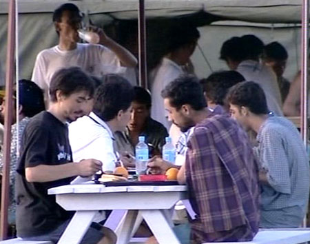 asylum seekers at the Nauru detention centre having dinner