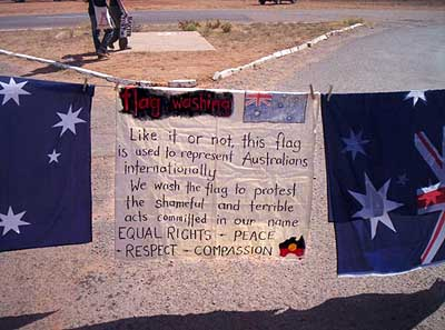 Washing the Australian flag at the Baxter detention centre during the Easter 2005 protests