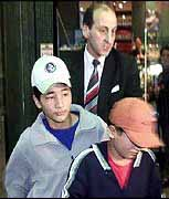 The boys: Ali and Monty Bakhtiyari with their lawyer in Melbourne, looking for a consulate