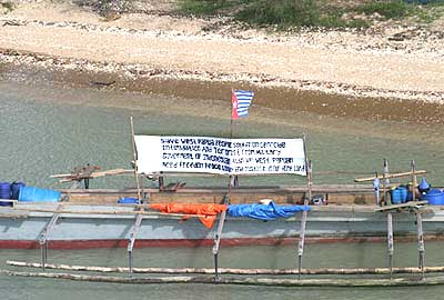 The banner on the canoe that made it all the way from Merauke to Weipa
