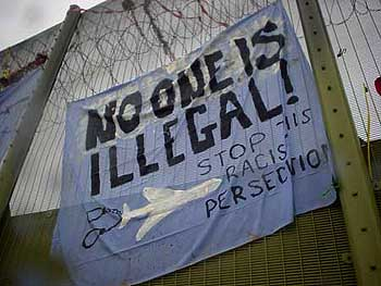 No One Is Illegal protest banner