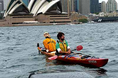 Big John is almost home: on Sydney harbour in David Corlett's kayak, against the backdrop of Sydney Opera House
