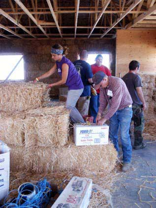 Straw Bale Housing: everybody's a helping hand